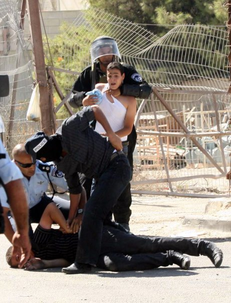 Unidentified Palestinian youth being arrested.